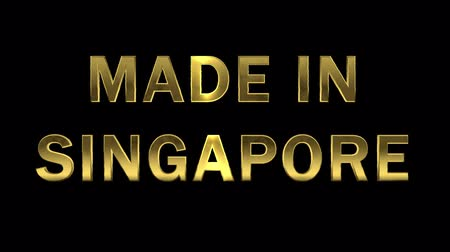 etiquette or : Lettres d'or collectant des particules - Made in Singapore
