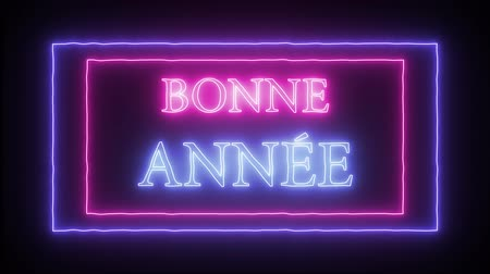 congratulating : Animation neon inscription Bonne Annee - Happy New Year in french language Stock Footage