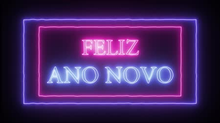 канун : Animation neon text Feliz Ano Novo - Happy New Year in portuguese language Стоковые видеозаписи