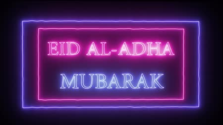áldás : Animation neon inscription Eid al-AdhaMubarak Stock mozgókép