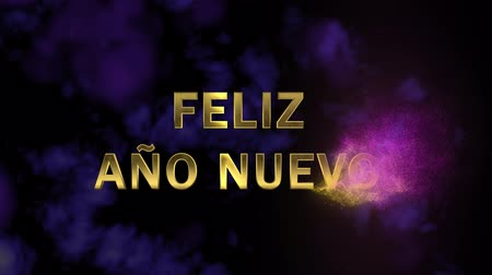 congratulating : Magical sparkling particles. Appearing golden letters Feliz Ano Nuevo Stock Footage