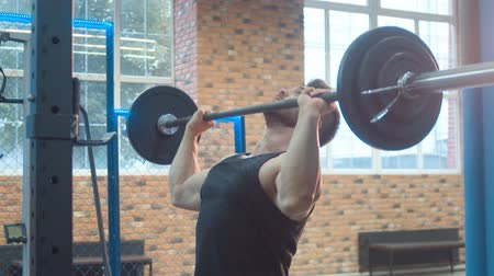 overcoming : Athlete Lifting Barbell