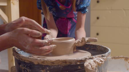 clay pot : Little potter working on a potters wheel