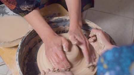 terrakotta : Female hands on a turning potters wheel