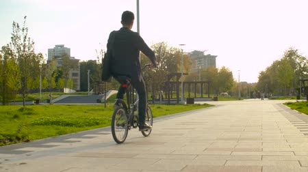 ecológico : Businessman in business suit riding a bike