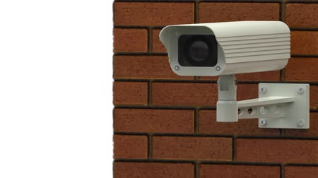 безопасность : Rotating surveillance camera on brick wall Стоковые видеозаписи