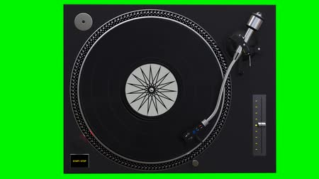 tonearm : Turntable spinning vinyl records on green chroma key background
