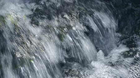 water fountain : Cristal potable flowing water from waterfall stream. Seamless loop footage.