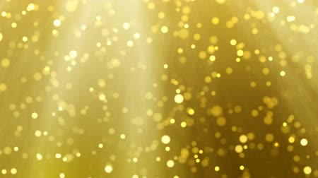 pré natal : Gold Christmas light loop background, glitter effect template. Elegant golden blur falling falling leaves. Xmas card 4k animation footage.