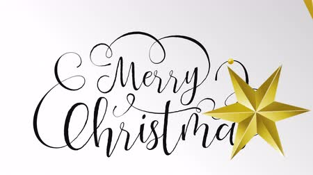 calligraphic : Merry Christmas typography animation of xmas quote on isolated white background with gold luxury stars decoration for video greeting card or celebration event presentation. 4k holiday footage. Stock Footage