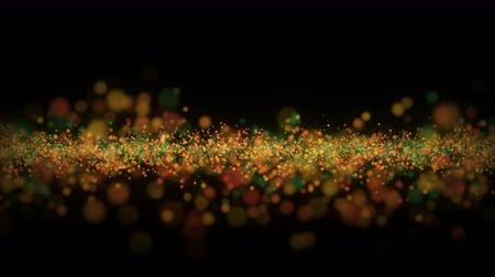 Abstract christmas glitter particle wave background in festive red and green colors. Colorful xmas lights on black night backdrop with copy space. Loopable holiday animation footage.