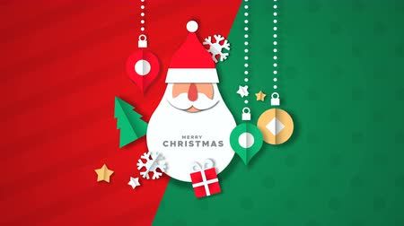 Merry Christmas animation, papercut santa claus face background with bauble ornament, gift and winter snowflake. Paper craft video greeting card of funny xmas character, holiday footage. Stock mozgókép