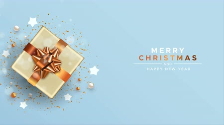 Merry Christmas happy new year animation of 3d gold copper gift box and holiday party decoration from top view angle. Video animated greeting card or intro presentation 4k xmas footage.