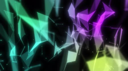 Abstract colorful geometric shape animation on black background for technology network or business presentation concept. Modern fast dynamic 4k footage.