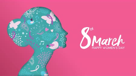 International Womens Day video card animation of paper cut woman face with hand drawn spring flowers on pink background. 2d women holiday event presentation footage, modern 4k social campaign template. Stock mozgókép