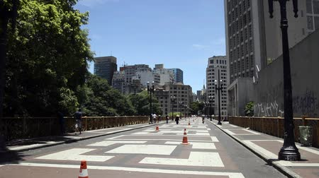 collagepeople : Sao Paulo, Brazil - January 17, 2016: Santa Efigenia Viaduct on the weekend. Use exclusively for pedestrians and bike, begins at Largo Sao Bento and end in front of church of Santa Efigenia.