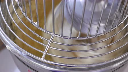 bandeja : Cream cheese being mixed in an industrial mixer Stock Footage