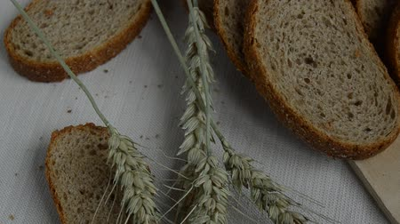 linen : Sliced whole grain bread on table with a tablecloth, ears lie close to, healthy eating, health day