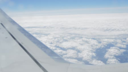 none : View through the window of the aircraft on the clouds and the wing Stock Footage