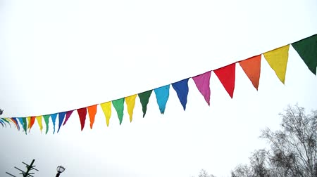 úterý : Colorful triangular flags waving in the wind, decoration for the holiday, outdoor