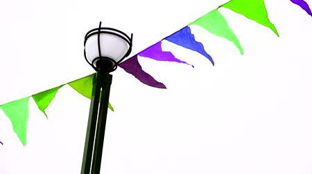 pontoon : Colorful triangular flags fluttering in the wind are tied to a lamppost. Decoration for holiday, outdoor