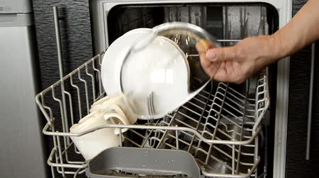 cserépedény : Womens hands open the dishwasher and take out clean sparkling dishes, showing it. Using modern technology to help with household chores
