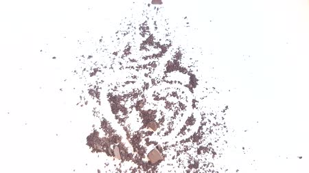 Scattered brown eye shadow or face powder on a white background, makeup and beauty concept Stock mozgókép