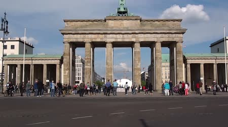 gates : BERLIN, GERMANY - MAY 8, 2014: Tourists in Berlin in front of Brandenburg Gate Stock Footage