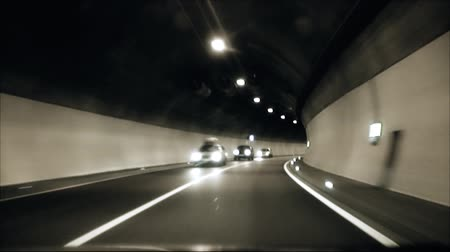 smokey : the car goes through a tunnel and exit it