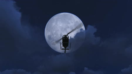 diurnal : Chopper flying at night with a full moon background video. Helicopter flying at night with a full moon and clouds footage Stock Footage