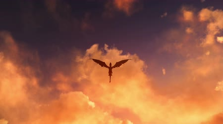 zamek : Mythological dragon flying at dusk or dawn with clouds of fire background video