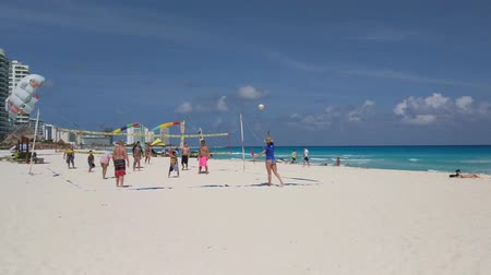 voleybol : Group of friends play beach volleyball in the hotel zone.
