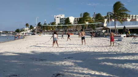 volleyball : Group of young people play beach volleyball in the hotel zone. Stock Footage