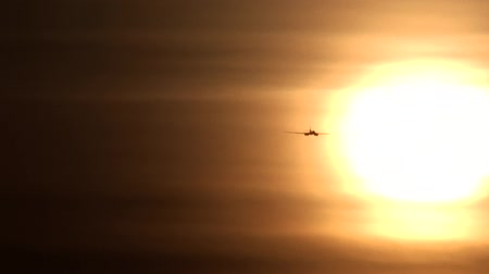 takeoff area : The plane flies towards the sun
