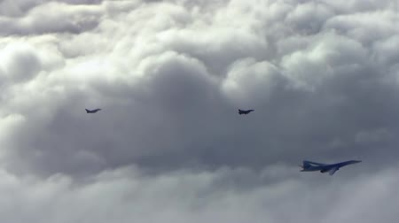cold war : Two fighter planes fly over bomber