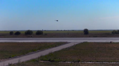 squadron : A small helicopter over the airfield Stock Footage