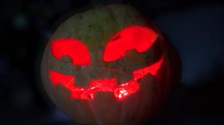 dekoracje : Pumpkin with red eyes