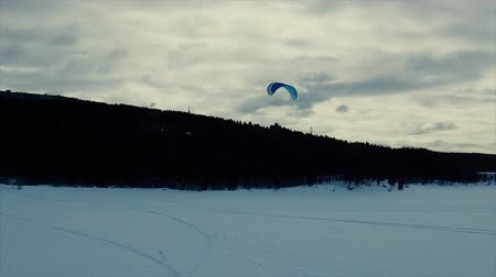 hang gliding : Paraglider flying over the lake