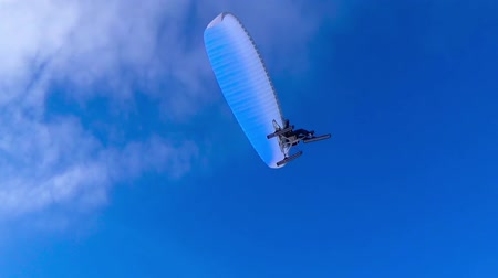 hang gliding : Man flying on a motorbike