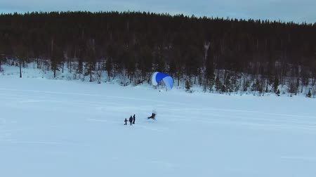 hang gliding : Man flying on a motorbike in winter Stock Footage