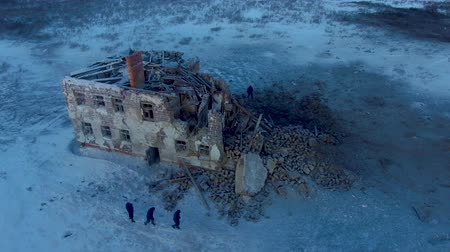 meteorite : People walk around the ruined house Stock Footage