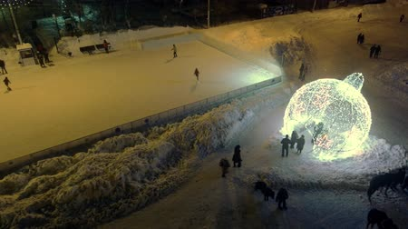 firecrackers : An ice rink and a ball of light
