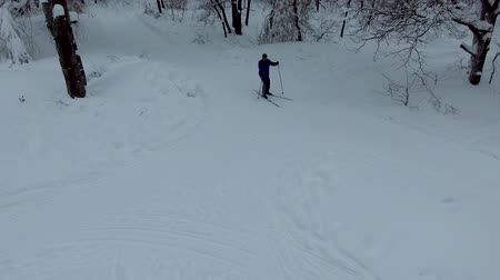 A skier passes by on the slopes