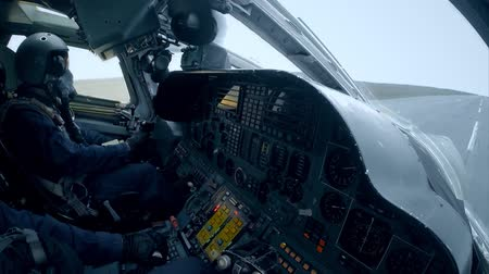 lutador : Pilots in the cockpit on takeoff Stock Footage