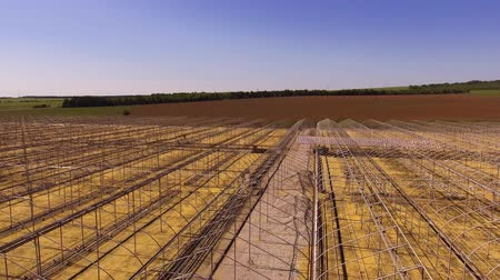 adapt : Long frames of greenhouses in the field
