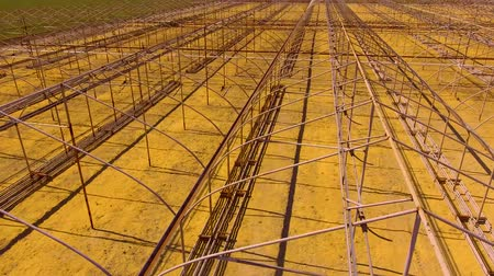adapt : Along the frames of greenhouses Stock Footage