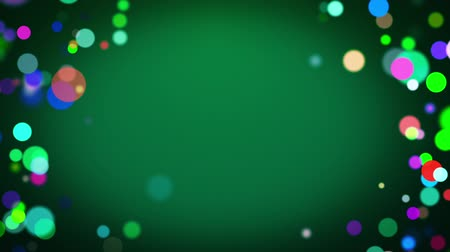 Colorful circles rainbow loopable background for centered text on green.