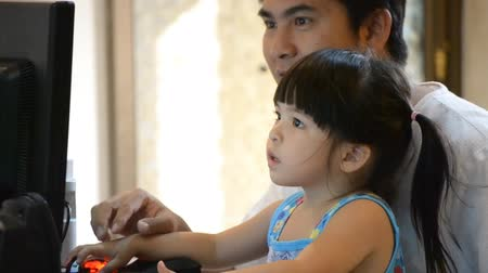 asian family : asian father teach cute daughter use computer Stock Footage
