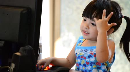 asian family : cute asian baby girl use computer
