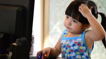 tajlandia : cute asian baby girl use computer